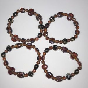 4 stretchy brown fun bracelets. From Dress barn
